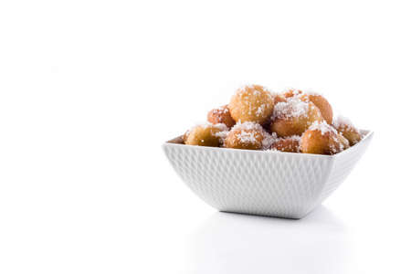 Carnival fritters or buñuelos de viento for holly week isolated on white background