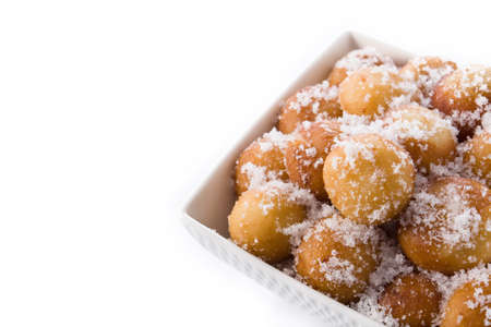 Carnival fritters or buñuelos de viento for holy week isolated on white background