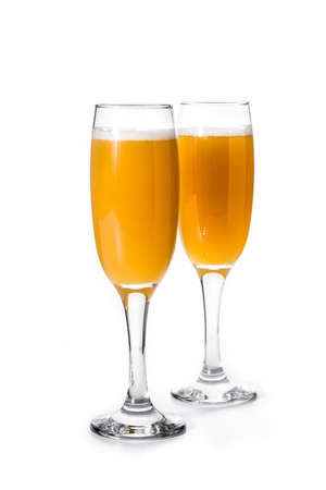 Bellini champagne cocktail in glass isolated on white background