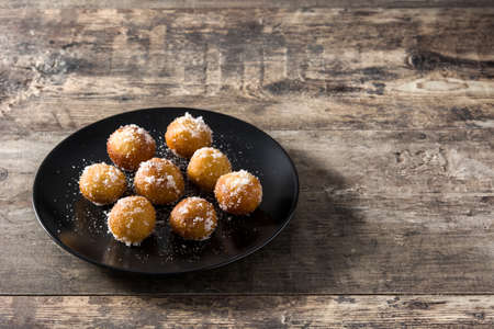 Carnival fritters or buñuelos de viento for holy week on wooden table