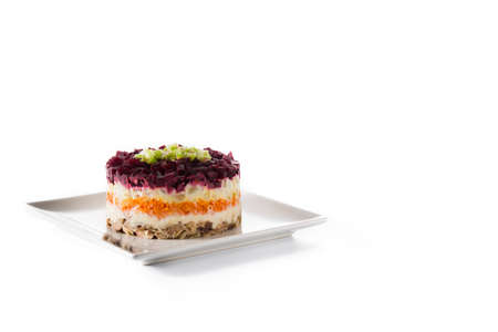 Traditional Russian herring salad with beetroot and carrots isolated on white background Stock Photo