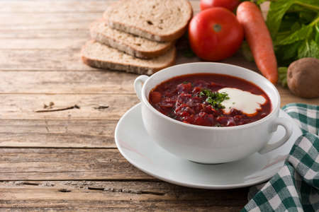 Traditional Ukrainian Russian borsch. Beetroot soup on wooden table
