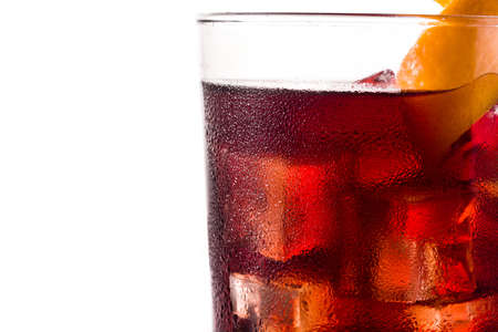 Boulevardier cocktail and orange zest isolated on white background Foto de archivo