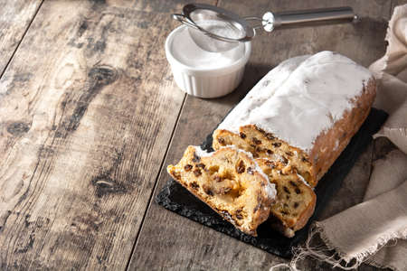 Christmas stollen fruit cake on wooden table