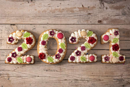 2021 cake on wooden background. New year concept. Stock fotó