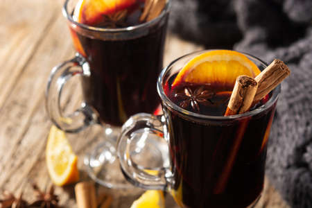 Traditional mulled wine with spices on wooden table Archivio Fotografico