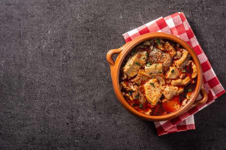 Traditional mondongo or el menudo soup on black background