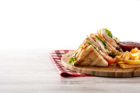 Club sandwich and French fries isolated on white background