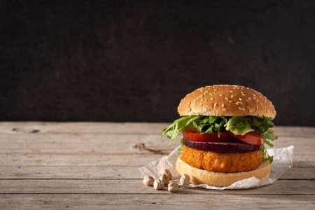 Delicious healthy chickpea burger. Alternative diet. Veganism food concept Standard-Bild