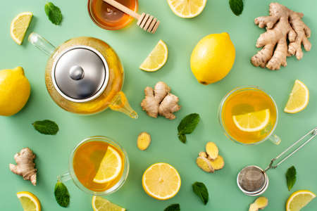 Ginger tea with lemon and honey pattern on green background