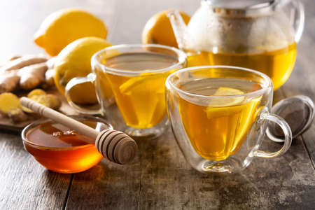 Ginger tea with lemon and honey on wooden table