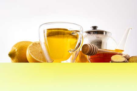 Ginger tea with lemon and honey on white background Standard-Bild