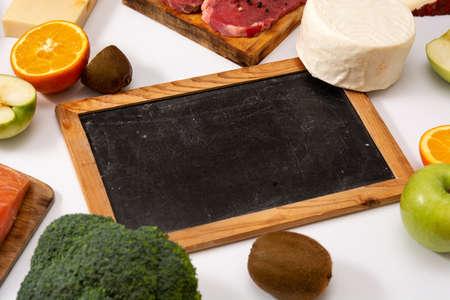 Vitamin A in food and blackboard mockup isolated on white background Standard-Bild