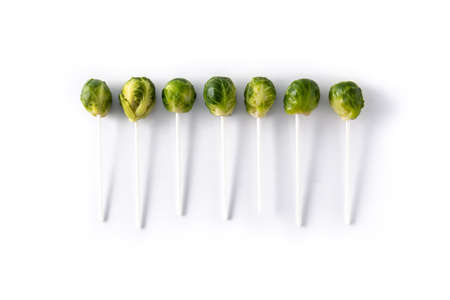 Set of brussel sprouts with lollipop sticks isolated on white background