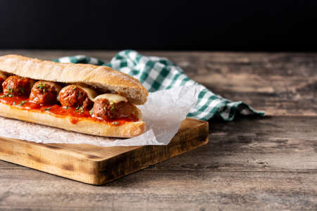 Meatball sub sandwich on wooden table.Copy space