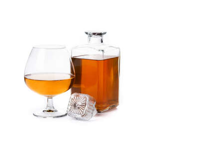 Cognac or whiskey drink isolated on white background