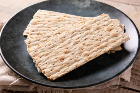 Traditional matzah bread on wooden table