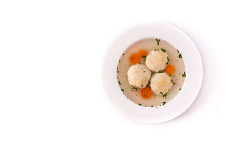 Traditional Jewish matzah ball soup isolated on white background