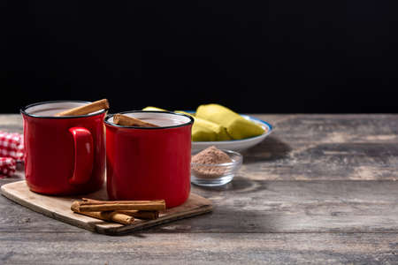 Traditional Mexican chocolate atole drink on wooden table