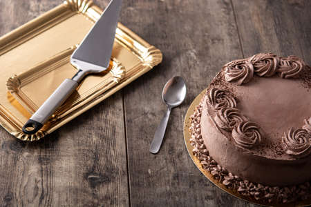 Piece of chocolate truffle cake on wooden table