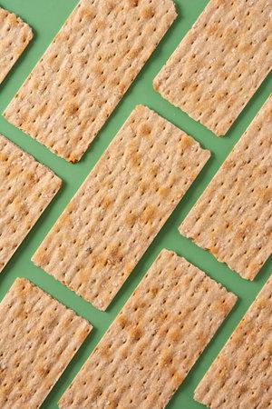 Traditional matzah bread pattern on green background