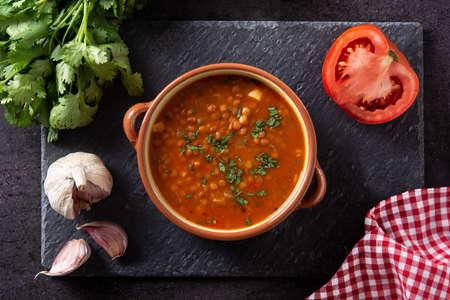 Red lentil soup on black slate background