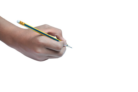 Hand holding a yellow pencil on white background photo