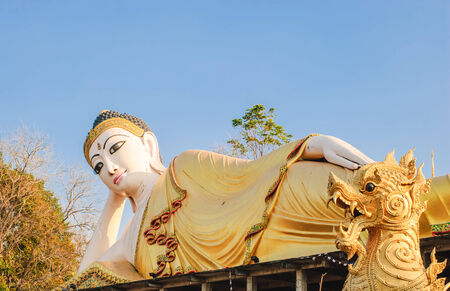 reclining: Lampang, Thailand - Januare 2, 2015: Reclining Buddha statue in Thailand known to be the largest reclining buddha in Thailand.