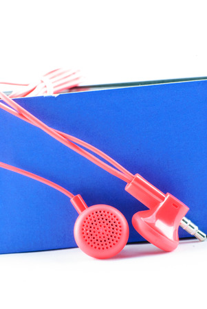 garniture: red wired headphones isolated over white background Stock Photo