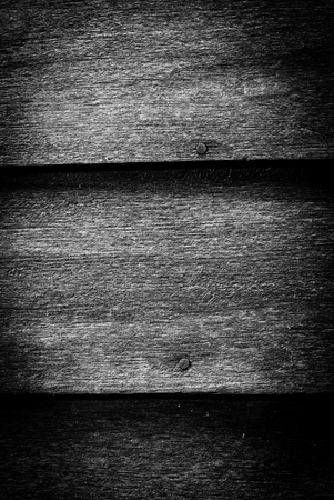 squalid: An old dark unpainted wooden exterior wall