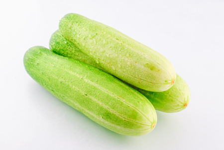 commercial medicine: Cucumber isolated on a white background in studio