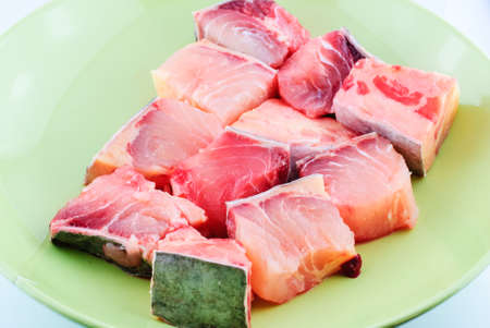seafish: fresh raw red fish fillet on green plate