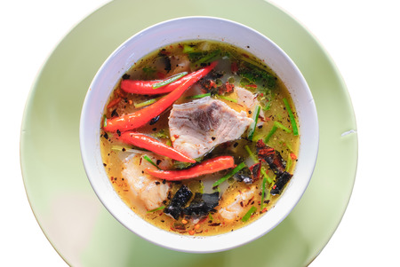 yum: Tom yum soup with fish in plate