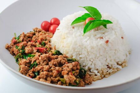 topped: Rice Topped With Stir-fried Pork And Basil and rice Stock Photo