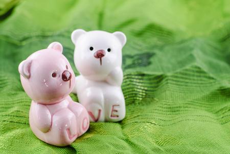 plush: Toy Plush Teddy Bear over green fabric background