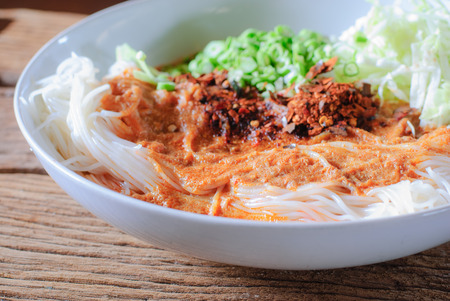 Thai rice vermicelli served with curry it is local Thai food photo