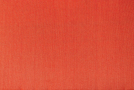 fabrication: close up image of orange fabric texture as background Stock Photo