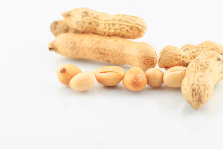 goober: pile of peanuts in shell isolated over white