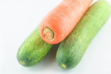 commercial medicine: Cucumber and carrot  isolated on a white background in studio