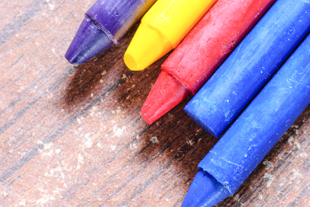 children painting: old crayons for painting for children in kindergarten