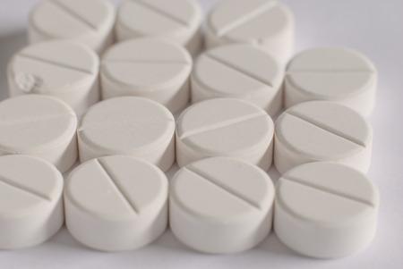 antibiotic pills: Heap of white round medicine tablet antibiotic pills Stock Photo