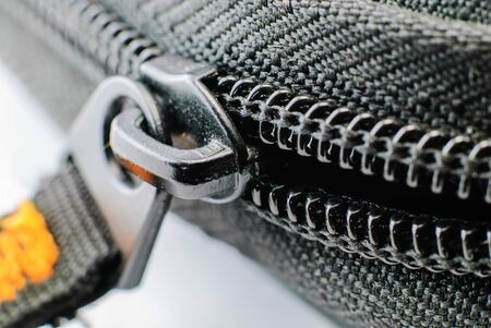unzipped: zipper concepts ideas opening zip unzipped construction Stock Photo