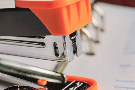 office stapler: Stapler on white paper business background , office object Stock Photo