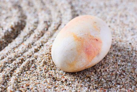 raked: zen stone garden round stone and raked sand making line patterns