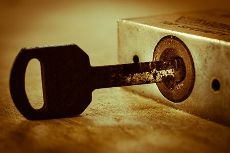 antique keyhole: Closeup of an old keyhole with key on a wooden antique