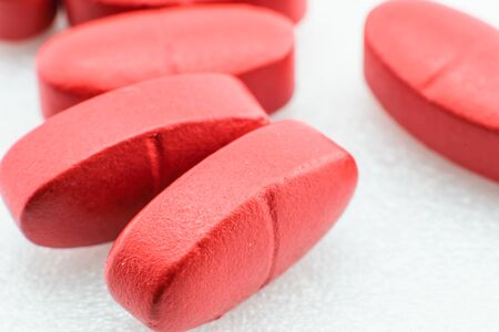 psychotropic medication: red pills isolated on white close up Stock Photo