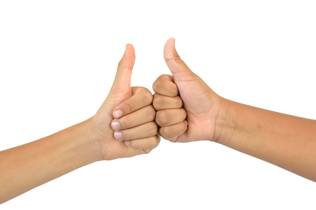 thump: mans hand with the thump up isolated on white background.