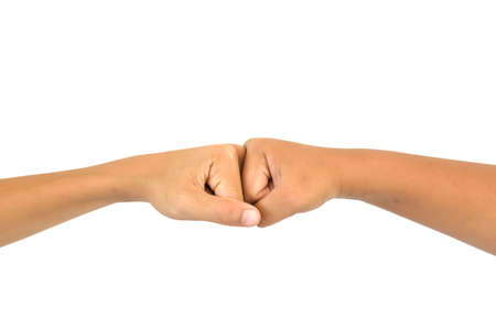 coherence: people giving a fist bumpFist bump hand sign coherence isolated in white background