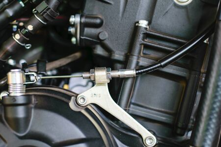throttle: throttle cable with motorcycle on background Stock Photo