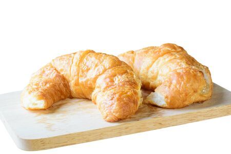 traditionally french: Fresh baked Croissants (close-up shot) on isolated in white  background Stock Photo